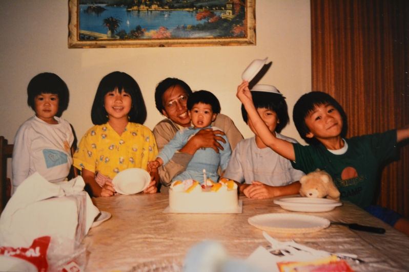 My first birthday, rocking a bowl cut beloved by Chinese people the world over rendering me a small, perturbed boy-like creature